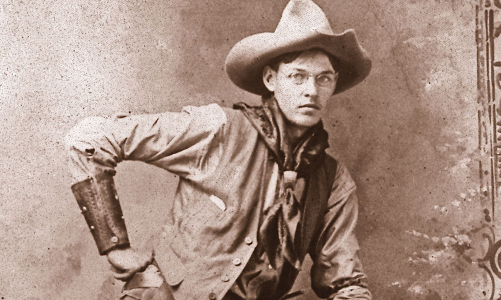 Ready to Ride The bespectacled buckaroo models the best gear he owns from his hat to his spurs, including his wild rag, fringed shotgun chaps, leather wrist cuffs and grass rope.  – True West archives –