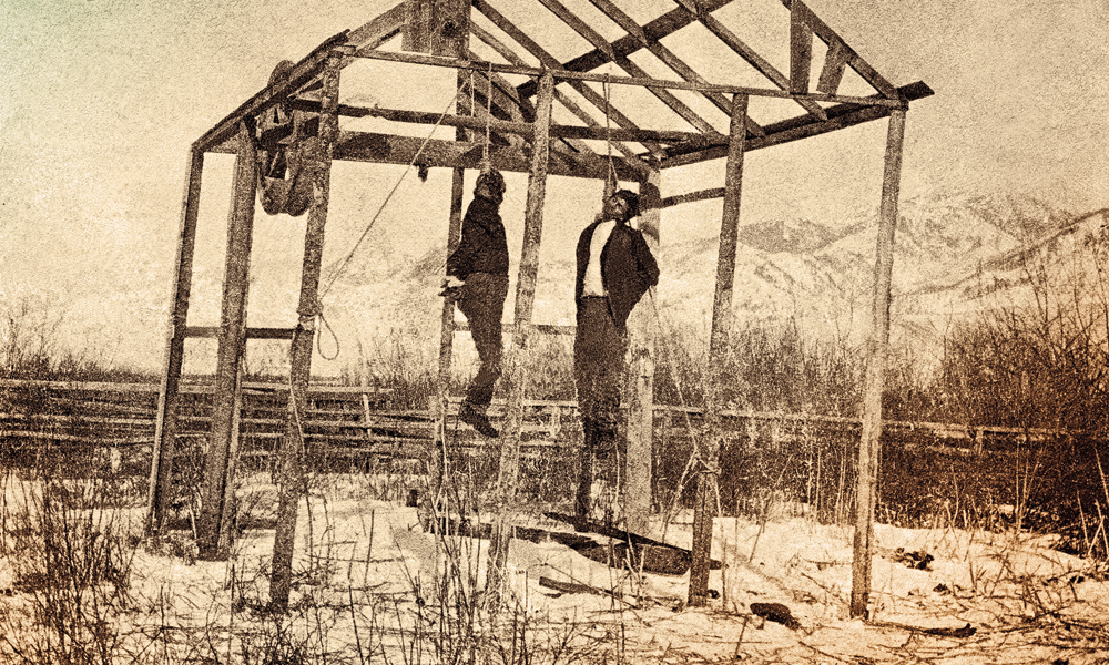 Against the backdrop of the beautiful Gallatin Range, Joshua Crissman took this ghastly photograph of the executed prisoners on Sunday morning, February 2, 1873. – Courtesy Museum of the Rockies –