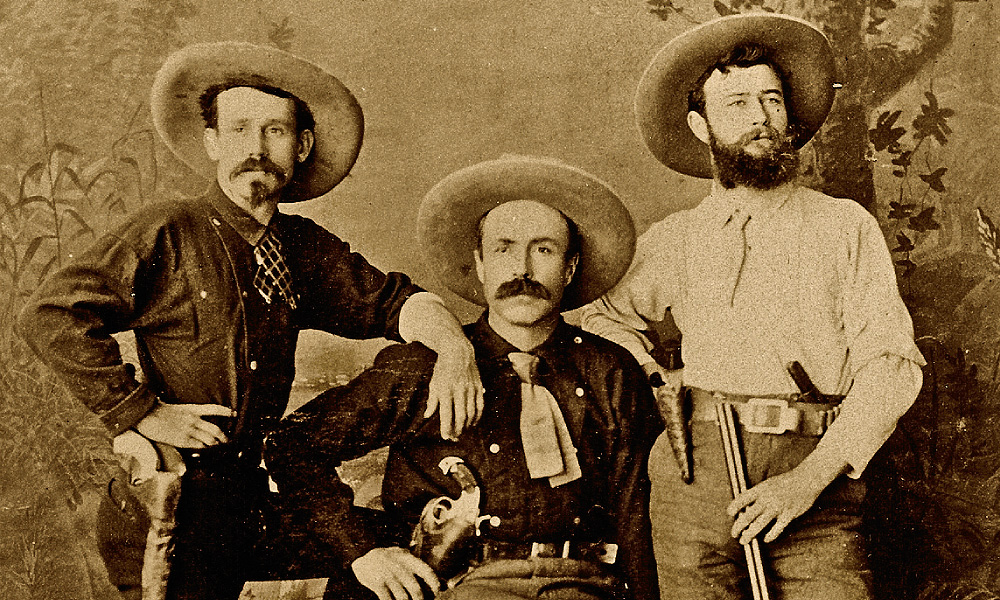 This trio of heavily armed, 1880s frontiersmen look like they are ready to take on just about anything. The hombre at left packs a '73 Colt Peacemaker, while his partner has opted for a double-action Merwin, Hulbert revolver. Although the man at the far right packs a small, unidentifiable revolver (probably strictly as backup), his hunter's-type bowie knife and trusty Medium Frame Colt Lightning pump rifle show that he knows his business. – Courtesy Herb Peck, Jr. Collection –