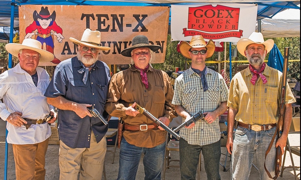 Holding a representative collection of the Old West guns used at the Autry Museum's black powder shoots are the posse that put these events together. They are (left to right) retired law-enforcement officers John Rives and Al Frisch; True West's Phil Spangenberger; along with the Autry's Senior Manager of Programs and Public Events Ben Fitzsimmons; and Chief Conservator Richard Moll. – All photos Courtesy Jack Aquino unless otherwise noted–