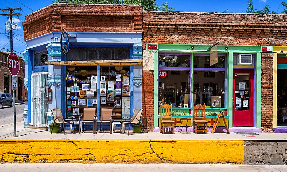 Visitors to Silver City's vibrant historic downtown district will discover the distinctive knee-high concrete curbs built after a series of floods inundated Silver City's business district in the 1890s and 1900s. – Courtesy Silver City Arts and Cultural District –
