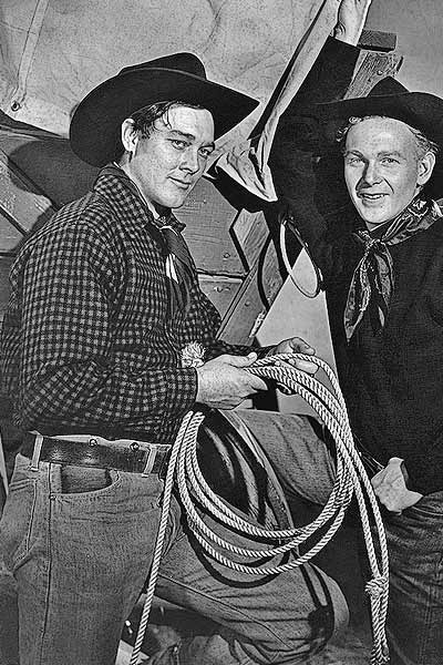 Harry Carey Jr. and Ben Johnson (from left) starred as horse traders who lead a wagon train of Mormons across the frontier West to their promised land in 1950's Wagon Master. Carey showed off the Navajo language he had learned on his parents' California ranch, while Johnson wowed everyone with one of the greatest examples of horsemanship ever filmed. – Courtesy RKO Radio Pictures –