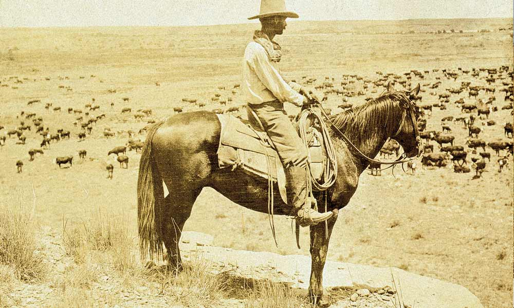 The clothing and hat styles in Lonesome Dove, set in the 1870s, adhere fairly close to this 1907 photo of a Texas cowboy taken by Erwin E. Smith. – Courtesy Library of Congress –