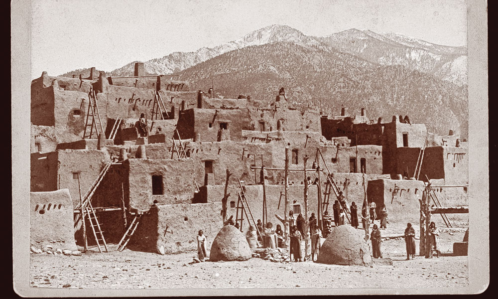 The Pueblo of Taos remains a crossroads of a thousand years of New Mexico culture and history. Taos Pueblo annually celebrates its heritage in the upper Rio Grande River Valley at numerous public festivals and dances. – Courtesy of Library of Congress –