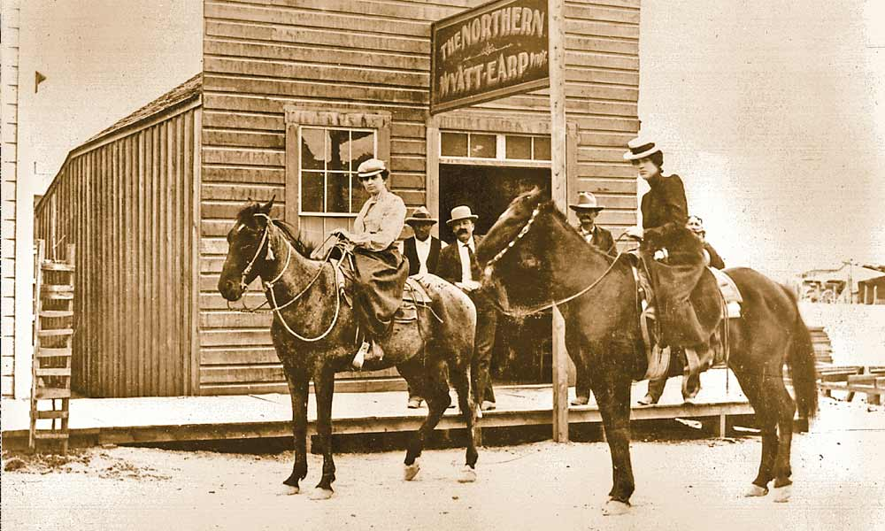 After becoming wealthy in the goldfields of Alaska, Wyatt and Josie Earp moved to the latest mining bonanza in Tonapah, Nevada, where they operated Wyatt Earp's Northern Saloon, some believe the woman on horseback at left is Josie. – True West Archives –