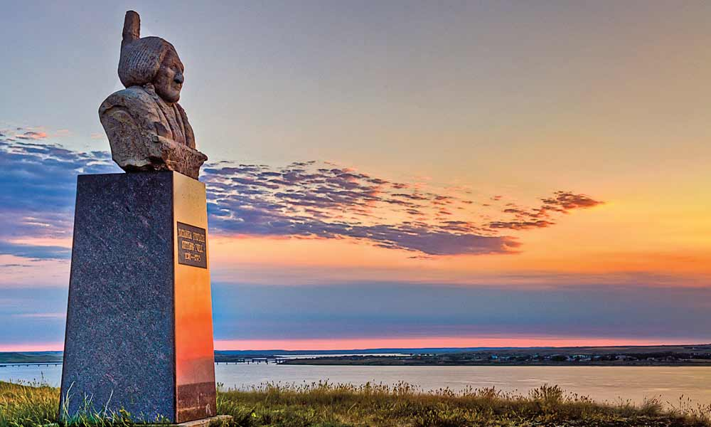 The second burial site of revered Lakota leader Sitting Bull sits on an isolated, scenic bluff overlooking the broad Oahe Reservoir on the Missouri River across from Mobridge, South Dakota, on the Standing Rock Sioux Reservation. – Photo by Chad Coppess –