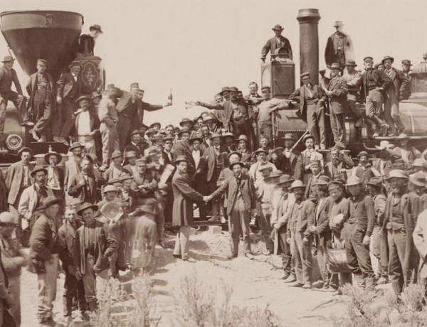 East_and_West_Shaking_hands_at_the_laying_of_last_rail_Union_Pacific_Railroad_-_Restoration-blog
