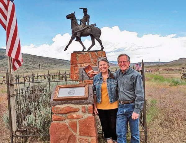 OWS_lead_Schoolteacher-Tri-Robinson-stands-with-his-wife,-Nancy,-at-the-reburial-site-in-Cody-WY-for-Mountain-Man-John-Liver-Eating-Johnston-