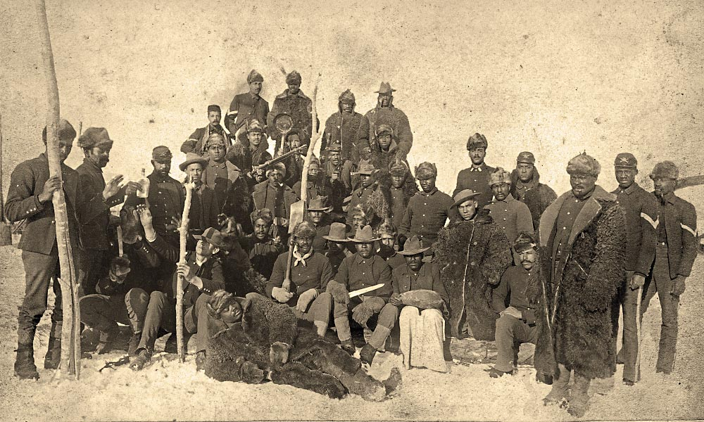 Cutting ice preserved food, a service done by these 1890 infantryman for the garrison at Montana's Fort Keogh, among the non-military tasks that required troop labor. – Courtesy Library of Congress –