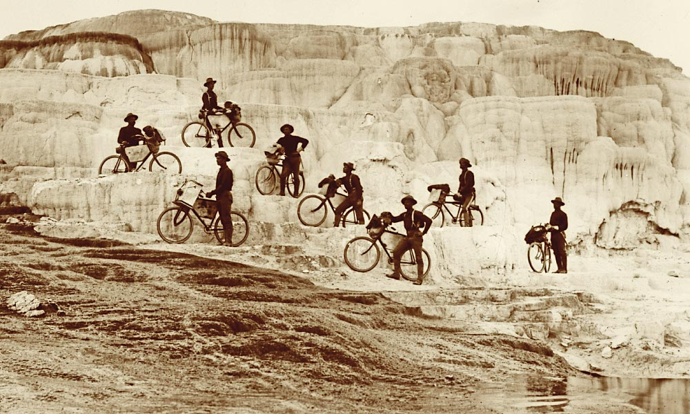 A handful of foot soldiers from the 25th U.S. Infantry stationed at Montana's Fort Missoula participated in a novel bicycle experiment to increase mobility in combat. Among their forays was a hard-going ride to Minerva Terrace in Yellowstone Park that took place during the fall of 1896. – Courtesy National Archives and Records Administration –