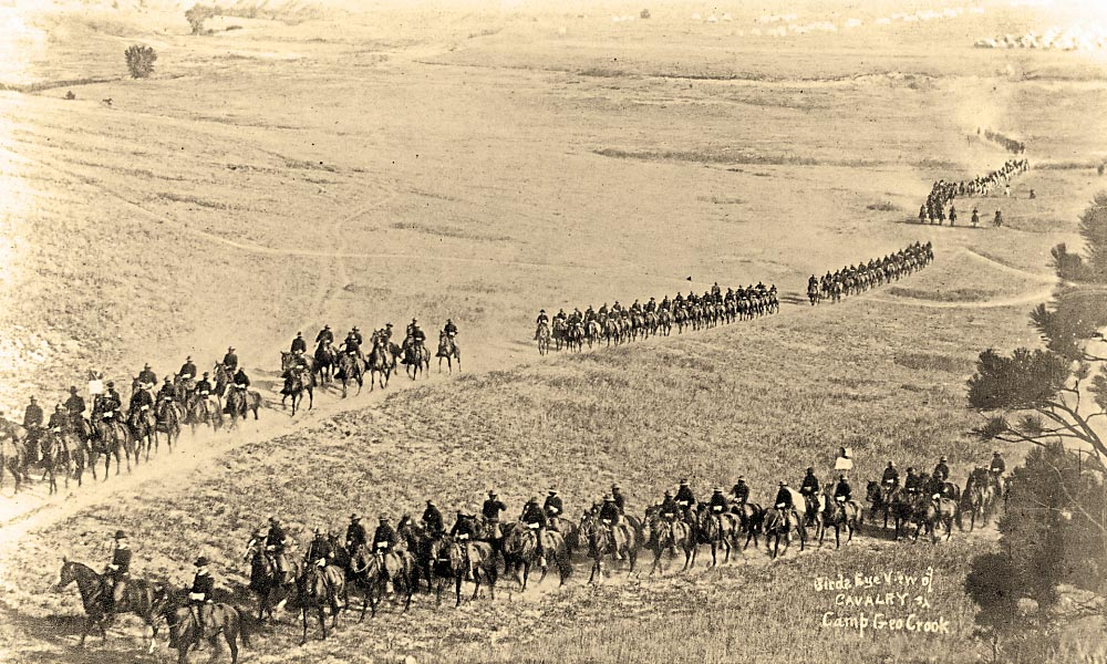 A squadron of the 9th U.S. Cavalry converges for field maneuvers during the 1890s. – Courtesy Nebraska State Historical Society –