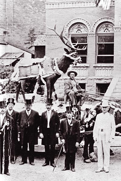 A spectacle to go along with the fireworks, Dr. William Rowan stands in his signature white suit, along with other members of the Ouray Elks Lodge, at a Fourth of July celebration in Ouray, Colorado, in 1910. He remained in Ouray the rest of his life, dying in 1926.