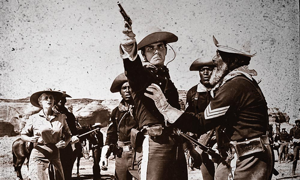 "In 1960, Woody Strode went from a respected black cavalry trooper on trial for heinous crimes in Sergeant Rutledge to a gladiator battling Kirk Douglas's character in Spartacus. His famous words as the sergeant resonate to this day: ""You're 9th Cavalry men, and like I've said again and again, the 9th's record is going to speak for us all one day, and its gonna speak clean."" – Courtesy Warner Bros. –"