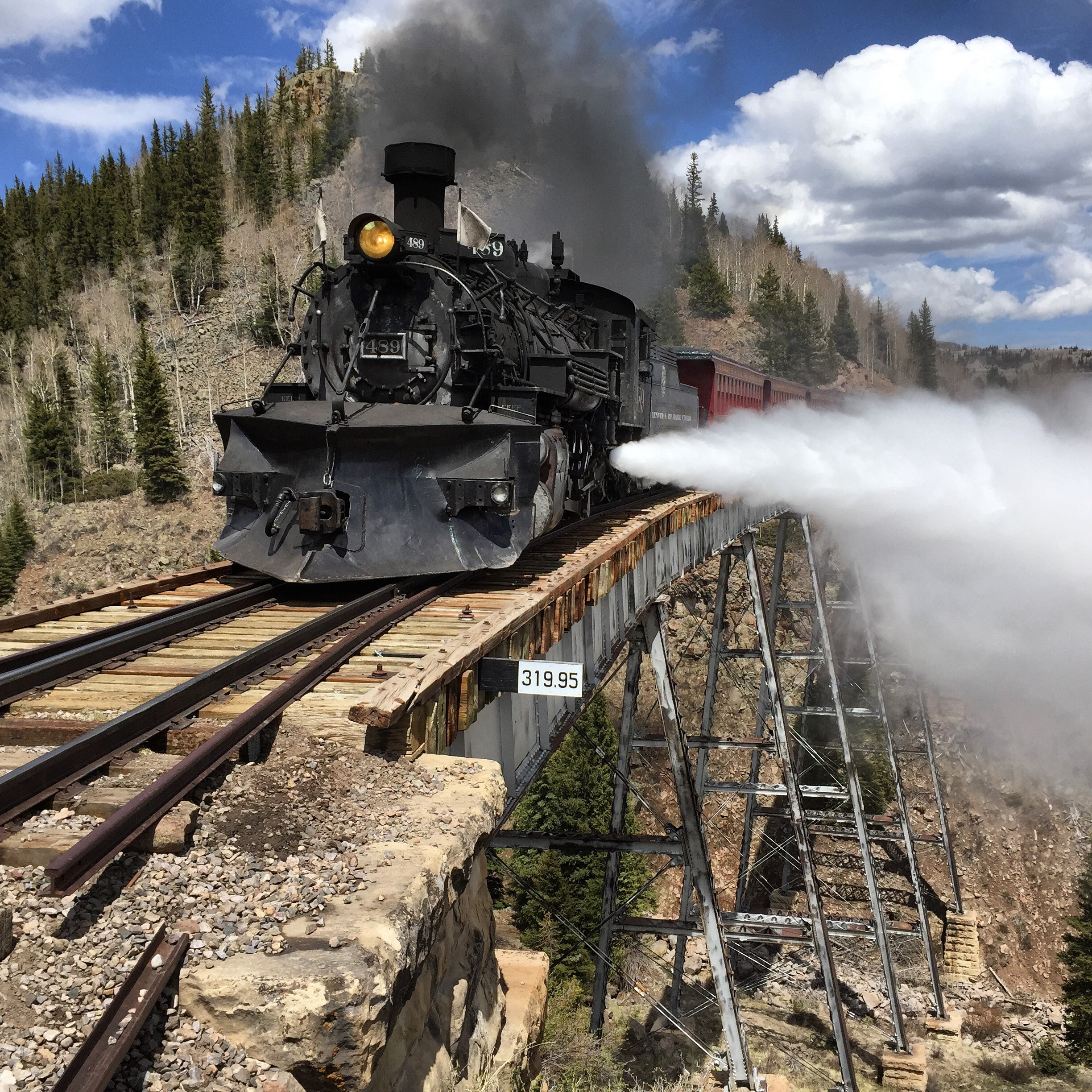 Ninety one year old locomotive #489 blows steam as she comes across Cascade Trestle - Courtesy Cumbres and Toltec Scenic Railroad -