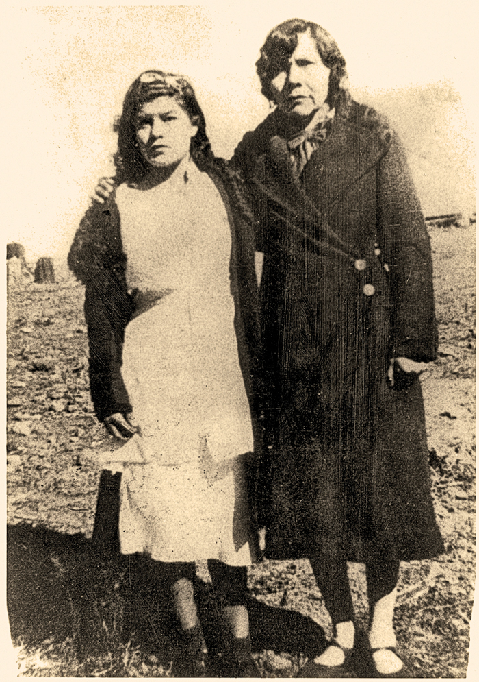 Lupe stands with her Mexican confidant, Soco, circa 1936, proving enemies could become friends. Lupe had held a lifelong hatred of Mexicans who she felt had preyed on the Apaches. – Courtesy Fimbres Family, Lynda A. Sánchez Collection –
