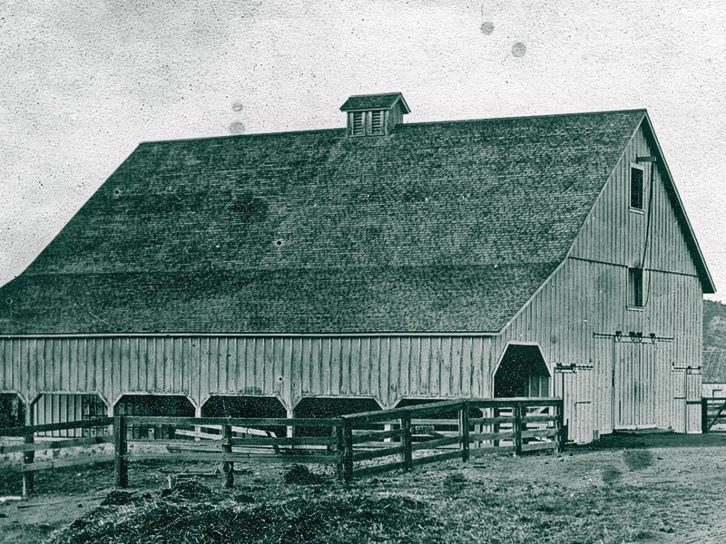 Bob McDaniel had the good fortune of knowing he helped saved a historic barn before he died, at the age of 86, this February. David Leonard Hoover's barn, shown circa 1890s, will house the Save Our Heritage Organisation's historic vehicles, such as the  Concord stage, shown in inset, with (from left) Bruce Coons, his wife, Alana, and stagecoach builder Jim Jensen. Next to the barn, you can see the 1884 Santa Ysabel  Store in the background. Turn to Opening Shot for a closer look. – Courtesy Save Our Heritage Organisation –