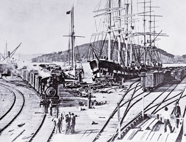 To save time and money in 1868, Central Pacific Railroad owners shifted their freight and passenger service to and from San Francisco to ferry, barge and shipping wharves in Oakland, California. – Courtesy Library of Congress –