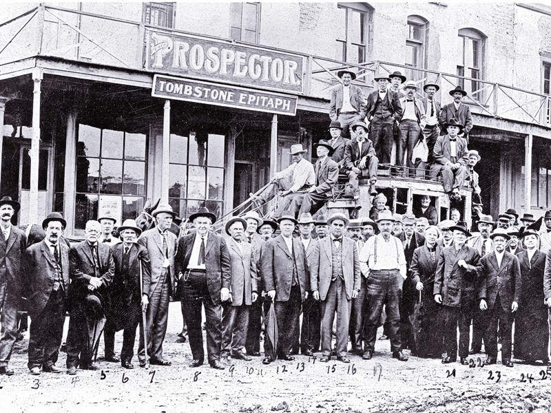 In this circa 1912 photo, Jim Young stands near the rear of the stagecoach, with  a group of other citizens of Tombstone, Arizona. He was a local fixture in  Cochise County, well into the 1930s. – Courtesy Arizona Historical Society –