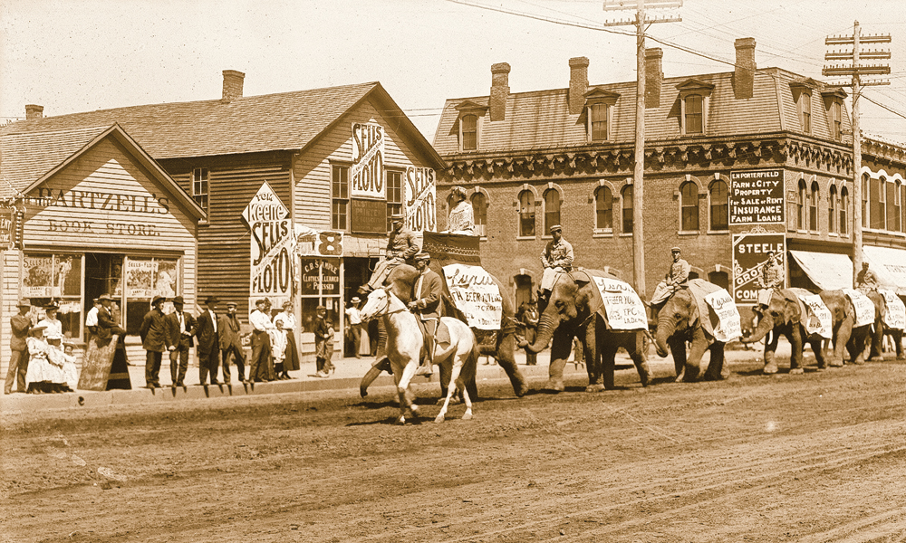 The Union Pacific Railroad connected Kearney to the nation, which brought the citizens of Buffalo County a 1908 visit from the circus. – Courtesy Nebraska State Historical Society, Solomon D. Butcher, nbhips, 13274 –