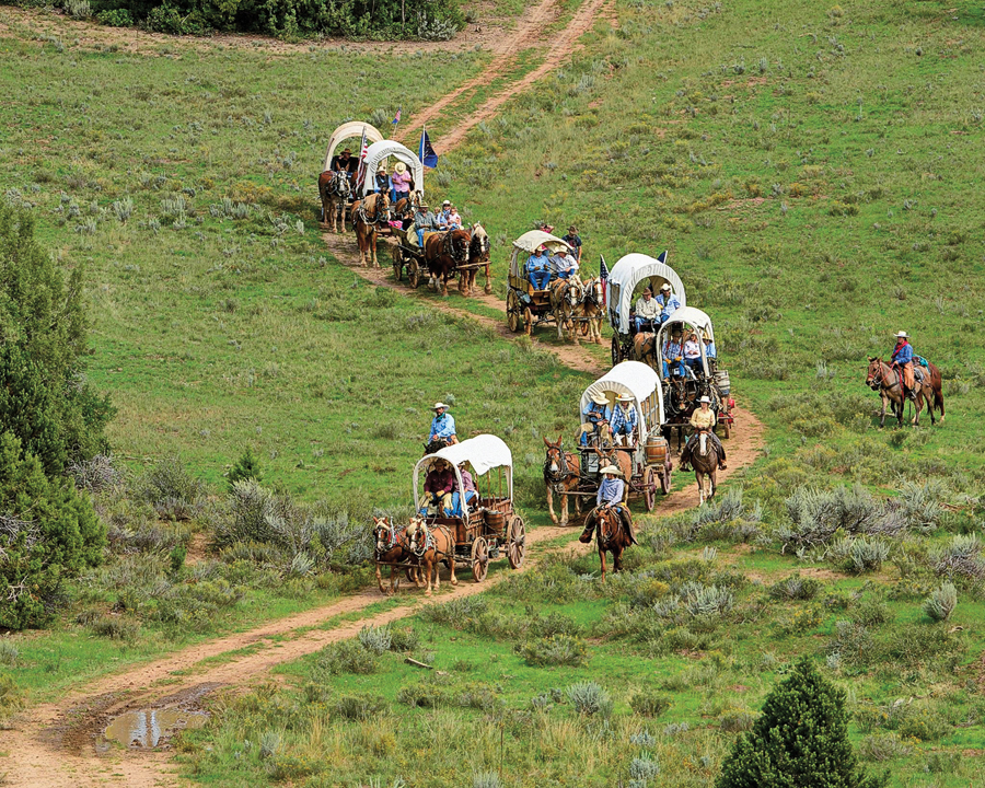 The annual three-day Western Legends Roundup Wagon Train is a 50-mile journey through Johnson Canyon and Grand Staircase-Escalante National Monument. Participants enjoy traditional Dutch oven cooking, cowboy entertainment, campfires and will see many locations used in Hollywood Westerns.