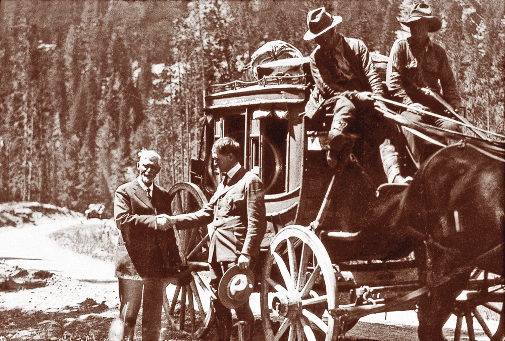 US_Charles-W--Cook-shaking-hands-with-Yellowstone-National-Park-superintendent-Horace-Albright-during-the-1922-Golden-Anniversary-celebration_scaled