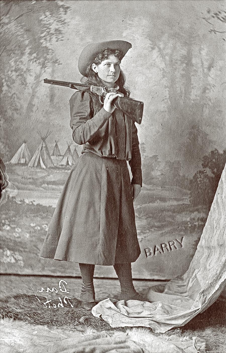 SF_3-HIST-for-GUN-No.-4-BBCW_Annie-Oakley-with-Winchester-1892-pointing-gun-backwards-P.69.1166