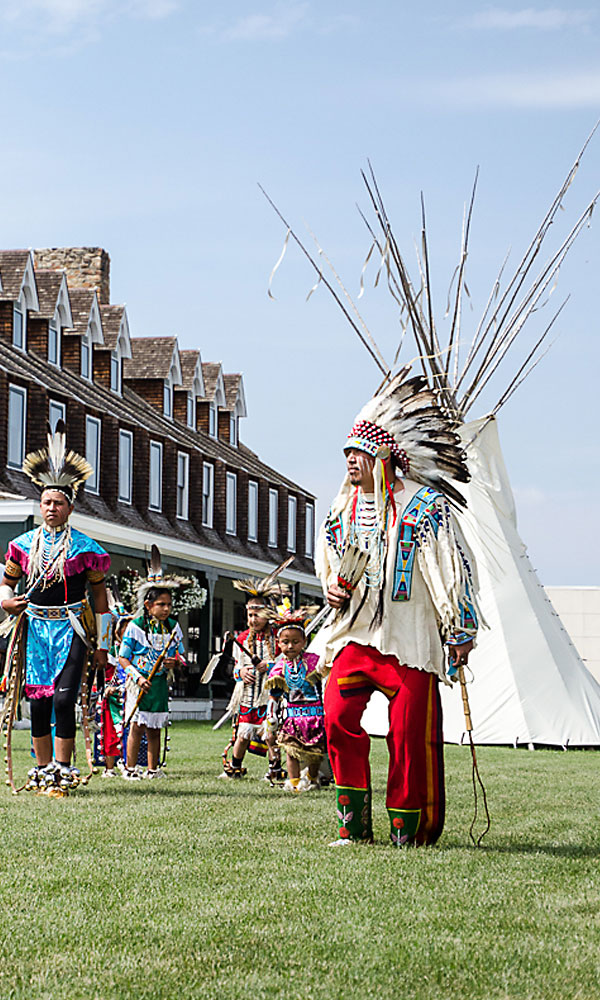 The recently restored Historic Sheridan Inn in Sheridan, Wyoming, hosts the First People's Pow Wow and Dance (above) on its lawn during Sheridan's WYO Rodeo Week. – Courtesy Sheridan CVB –