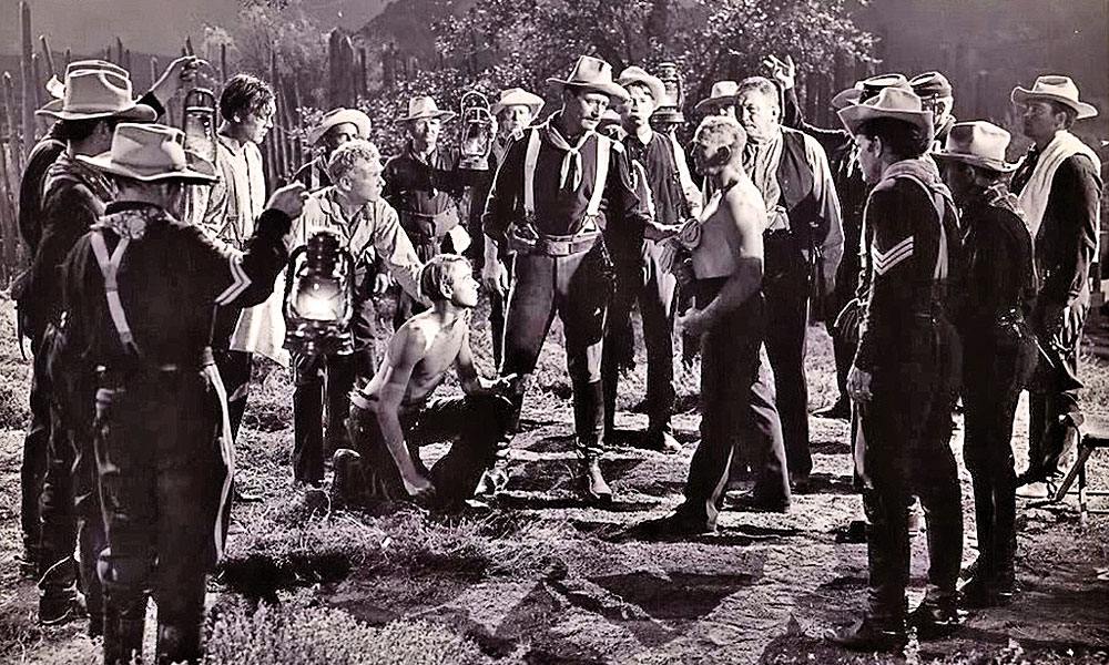 WM_Fred-Kennedy-as-Trooper-Heinze-standing-shirtless-next-to-John-Wayne-died-on-the-set-in-Constance-Towerss-arms