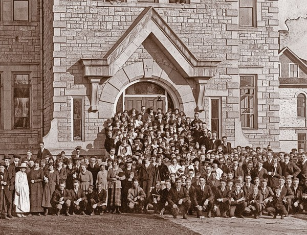 """Oneida Stake Academy, shown here in the 1910s, was built in the 1890s with volunteer labor and financed by community giving—everything from donating a pig to selling a cow to cutting rocks. """"Everything in the building is hand made, down to the bolts,"""" Necia Seamons says. """"Children came here from a very large area and had to board with people in the community. It was a major commitment to get an education."""" – Courtesy Oneida Stake Academy Museum and Community Center –"""