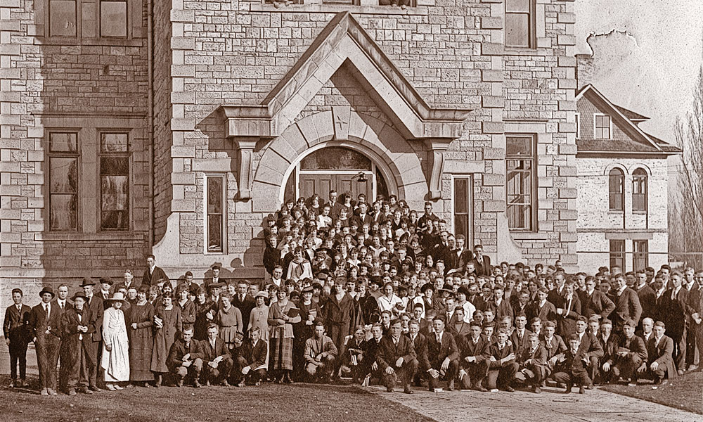 "Oneida Stake Academy, shown here in the 1910s, was built in the 1890s with volunteer labor and financed by community giving—everything from donating a pig to selling a cow to cutting rocks. ""Everything in the building is hand made, down to the bolts,"" Necia Seamons says. ""Children came here from a very large area and had to board with people in the community. It was a major commitment to get an education."" – Courtesy Oneida Stake Academy Museum and Community Center –"
