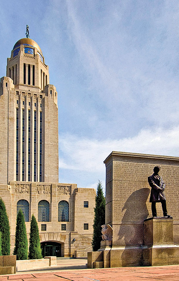 Nebraska's third state capitol building in Lincoln was constructed from 1922 to 1932. From 1854 to 1867 the territorial government was in Omaha. The first state legislature moved it to the edge of the western settlements south of the Platte River to the village of Lancaster and renamed it Lincoln. – Courtesy Nebraska Tourism –