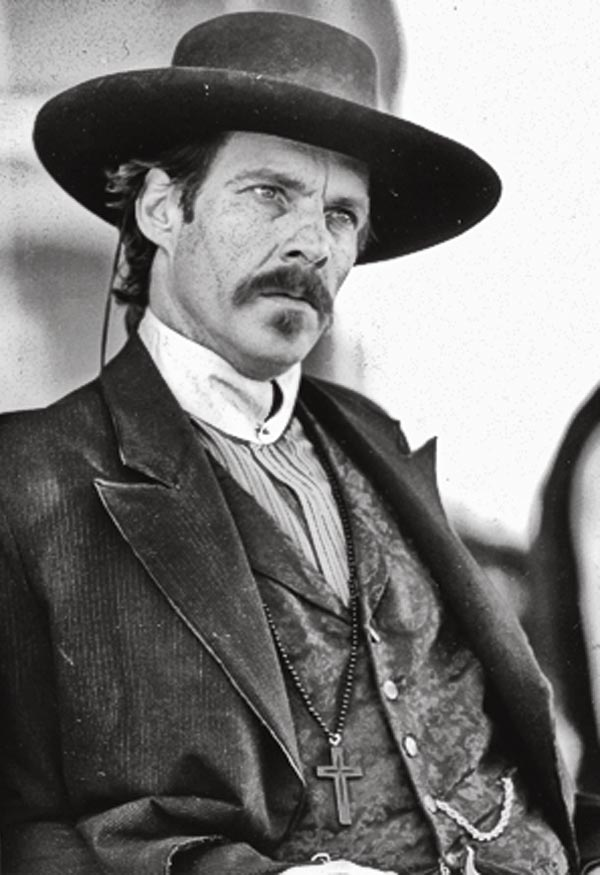 The best Doc in the movies is Val Kilmer in 1993's Tombstone. The second best was Dennis Quaid in 1994's Wyatt Earp (left). He put a harder edge on Doc's personality; if he had better lines (and wardrobe), he might have been a more realistic, if less appealing Doc.