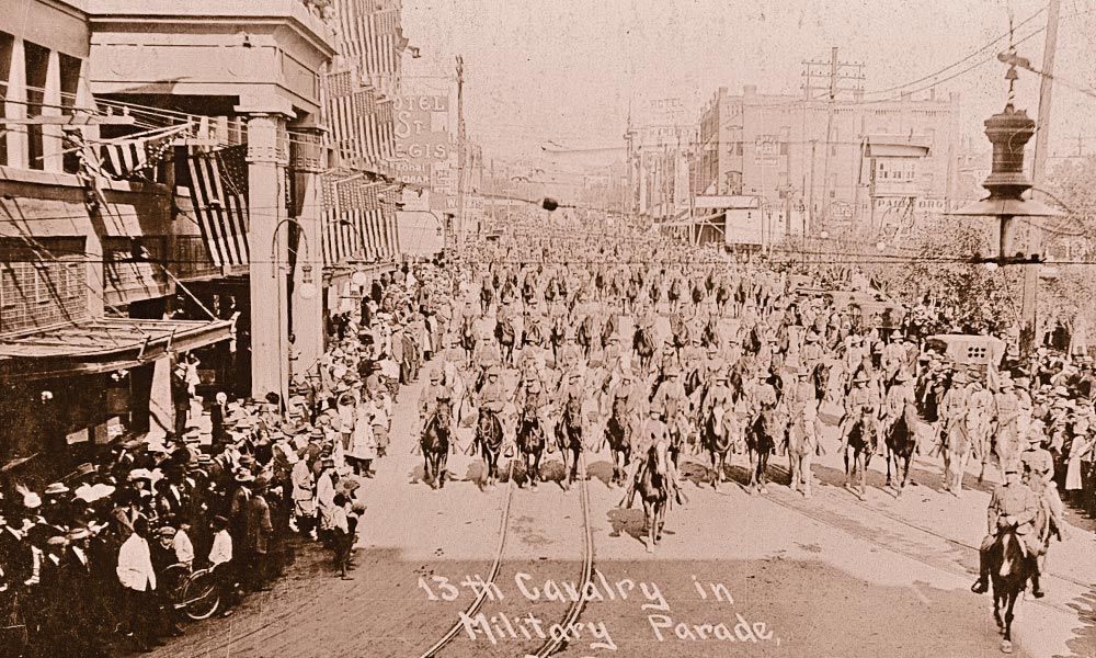 El Paso's martial heritage spans centuries and continues with the presence of Fort Bliss, a former frontier army post-turned-modern garrison. Troopers from the 13th U.S. Cavalry, shown parading through the downtown in early 1900s, were among the many units stationed in the area. – Courtesy Yale Collection of Western Americana, Beinecke Rare Book and Manuscript Library –