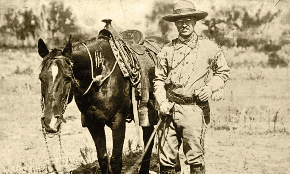 Theodore Roosevelt returned to his beloved Maltese Cross Ranch in Medora in early 1884 after the passing of his wife and mother on Valentine's Day. Roosevelt embraced the rancher's life and posed with his trusted horse, Manitou, in Medora, circa 1885. – Author's Collection –