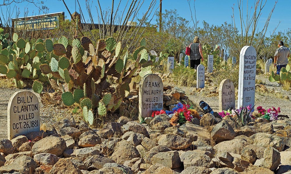 Visitors to Tombstone can pay their respects to the Cowboys Billy Clanton, Frank, and Tom McLaury at Boothill before gunfighters re-enact famous shootouts in the historic district during one of the town's annual festivals.